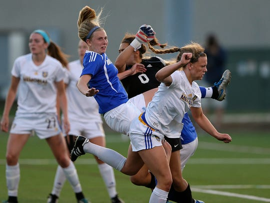 Green Bay Notre Dame's Grace Shaw (6) collides with