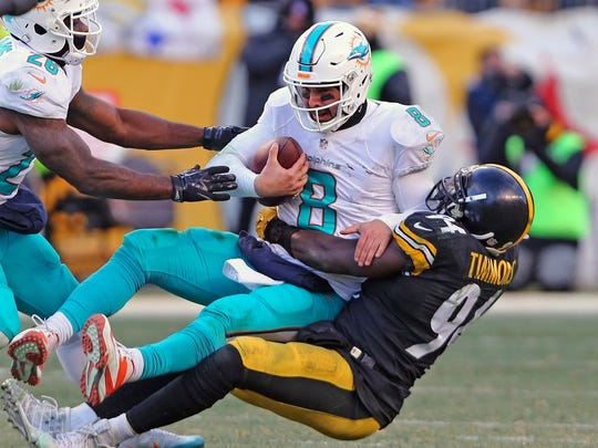 Miami Dolphins quarterback Matt Moore gets sacked by Pittsburgh Steelers' Lawrence Timmons in the second half of an AFC wild-card NFL football game in Pittsburgh on Sunday.