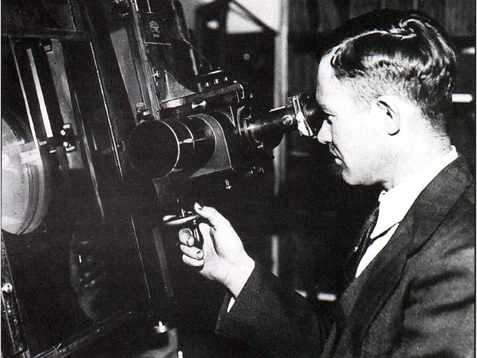 Lowell Observatory assistant  Clyde Tombaugh uses the