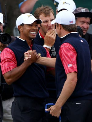 Tiger Woods celebrates with Nick Watney during the USA's Presidents Cup victory in 2011.