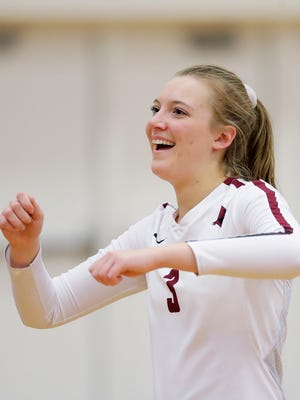De Pere's Greta Zahn (3) dances after the Redbirds defeated Pulaski 3-1 in a WIAA regional girls volleyball game at De Pere high school on Thursday, October 19, 2017 in De Pere, Wis.Adam Wesley/USA TODAY NETWORK-Wisconsin