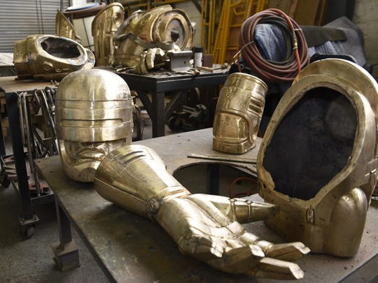 Various body parts of the RoboCop statue are displayed