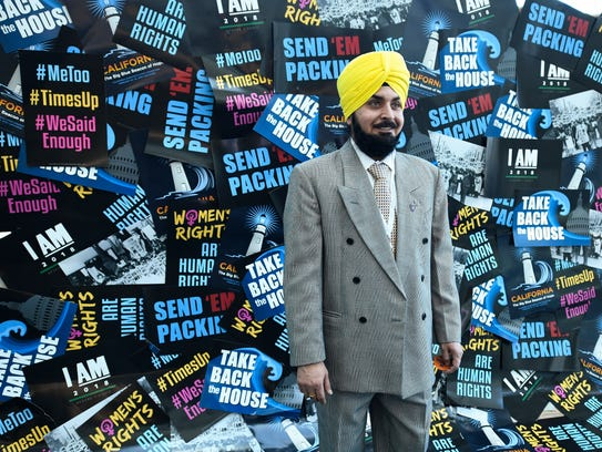 Delegate Tejinder Dhami poses at a photo booth at the