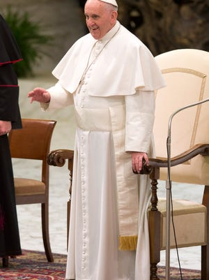Pope Francis salutes the faithful during a special audience with members of the dioceses of Cassano allo Jonio in southern Italy.