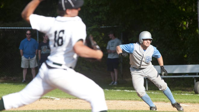 South Burlington's Henry Cunningham, right, takes a lead off of first base as Rice pitcher Will Hesslink fires to the plate during last week's baseball game in South Burlington.
