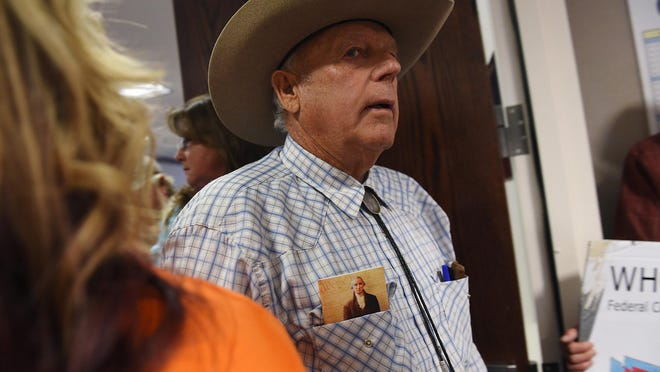 Nevada rancher Cliven Bundy arrives at the Nevada State Legislature building to rally behind a bill seeking to reclaim land from the federal government in Carson City, Nev. on March 31, 2015.