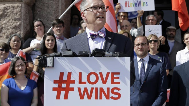 Jim Obergefell, the named plaintiff in the Obergefell v. Hodges Supreme Court case that legalized same-sex marriage nationwide, is backed by supporters of the court's ruling on same-sex marriage on the steps of the Texas Capitol during a rally in Austin, Texas, on June 29. The Supreme Court declared that same-sex couples have a right to marry anywhere in the United States.