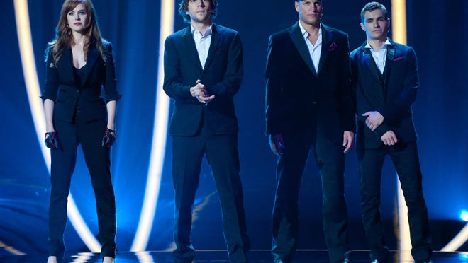 """This film image released by  Summit Entertainment shows, from left, Isla Fisher, Jesse Eisenberg, Woody Harrelson and Dave Franco in a scene from """"Now You See Me."""" (AP Photo/ Summit Entertainment, Barry Wetcher)  ORG XMIT: NYET846"""