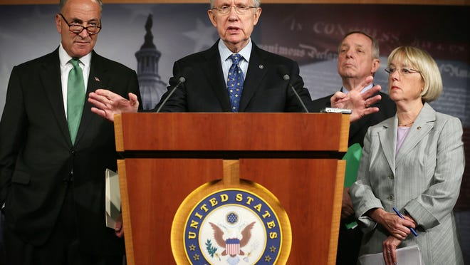 Sen. Harry Reid, center, with his top Democratic lieutenants from left, Charles Schumer, Dick Durbin and Patty Murray. (Alex Wong, Getty Images)