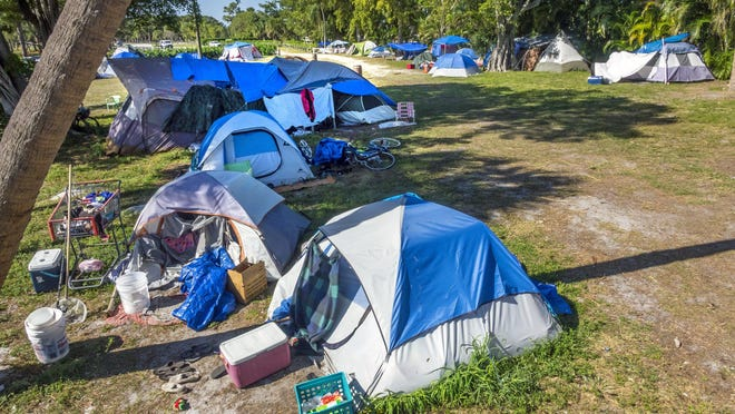 Tent City sprawls out over a football field size area in John Prince Park west of Lake Worth Beach. Homeless people have erected about 70 tents in the county park and under current law, the county can't force them to leave.