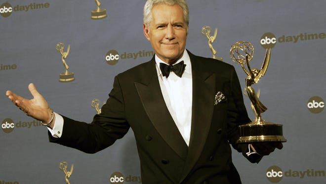 "Alex Trebek holds the award for outstanding game show host for his work on ""Jeopardy!"" backstage April 28, 2006, at the 33rd Annual Daytime Emmy Awards in Los Angeles."