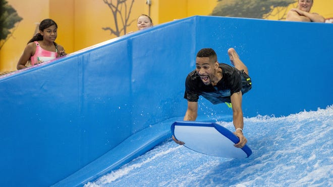 Quin Vallier of Round Rock boogie-boards at the indoor water park at Kalahari Resorts and Conventions Round Rock during the grand opening on Thursday.