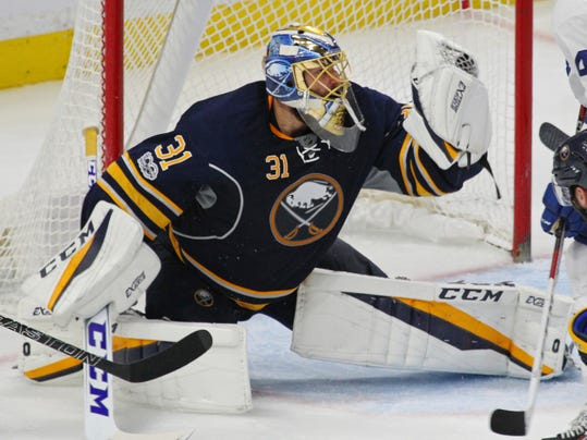 Buffalo Sabres goalie Anders Nilsson (31) makes a glove save during the third period of an NHL hockey game against the Toronto Maple Leafs, Monday, April 3, 2017, in Buffalo, N.Y. (AP Photo/Jeffrey T. Barnes)