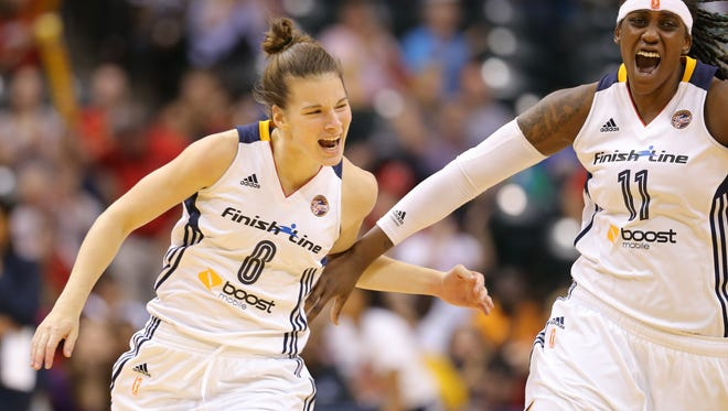 Indiana Fever guard Maggie Lucas celebrates a three-point basket with teammate Lynetta Kizer.