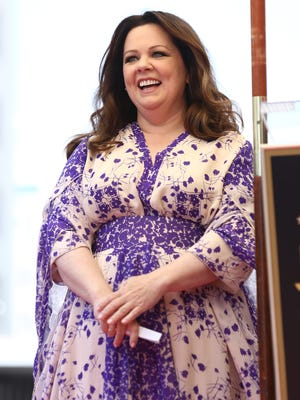 Actress Melissa McCarthy poses as she is honored with a star on the Hollywood Walk Of Fame on May 19, 2015 in Hollywood, California.
