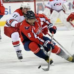 Ovechkin nets 50th, adds assist, Capitals top Hurricanes 4-2