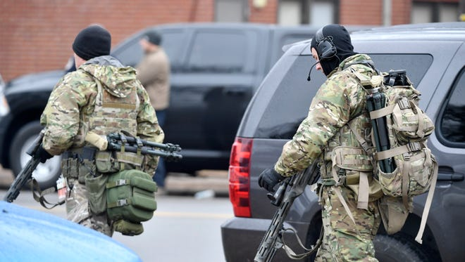 Police gather in the area where a shooting was reported about 8:40 a.m. Wednesday, February 7, 2018, at Tony Sudekum Apartments on Charles E. Davis Boulevard in Nashville, Tenn.