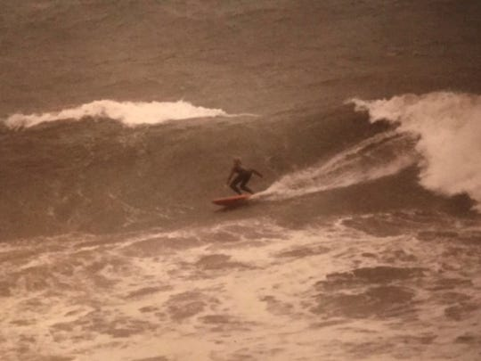 Keith Buff riding a hurricane wave before his accident.