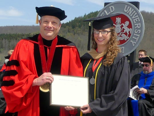 Mansfield University President Scott Barton presents the Outstanding Senior Award to Mackenzie Hafer.