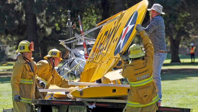 The World War II-era trainer airplane that Harrison Ford crash-landed Thursday is removed from Penmar Golf Course in Venice, Calif., March 6.