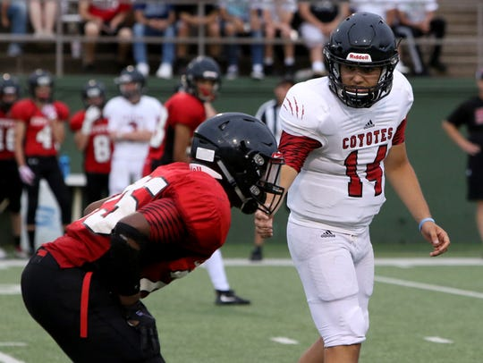 Wichita Falls High School senior quarterback Anthony Vargas (14) dedicated himself to getting more athletic, losing more than 50 pounds in preparation for the upcoming season.