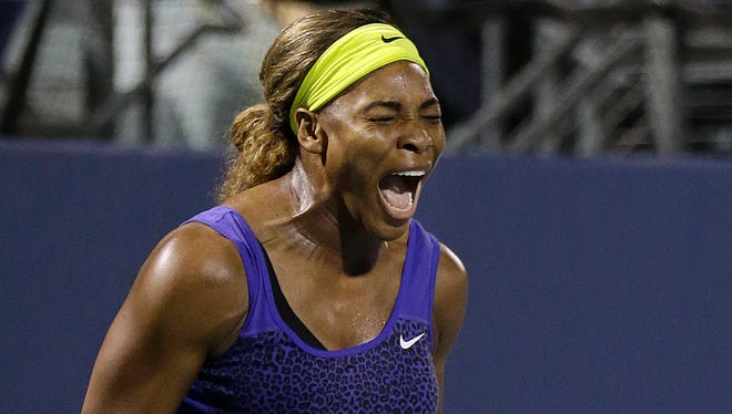 Serena Williams celebrates after beating Ana Ivanovic, from Serbia, during their match in the Bank of the West Classic tennis tournament in Stanford, Calif.
