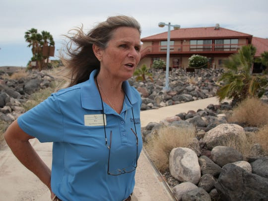 Kim Roundtree, general manager of Callville Bay Resort & Marina, talks about the challenges of moving the marina farther and farther downhill as the water level of Lake Mead has dropped. She is standing at the high-water mark, where the lake level stood more than 14 years ago.