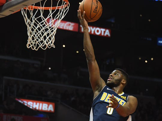 Denver Nuggets guard Emmanuel Mudiay (0) shoots against the LA Clippers in the fourth quarter at Staples Center.