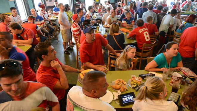 Soccer fans gather at Mellow Mushroom as part of the American Outlaws: Pensacola on Monday to watch USA take on Ghana in the World Cup.   Ben Twingley/btwingley@pnj.com Soccer fans gather at Mellow Mushroom as part of the American Outlaws of Pensacola on Monday to watch USA take on Ghana in the World Cup.