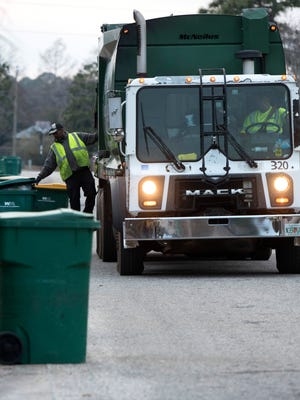 Waste Pro USA crew collects trash off Fox Den Drive in Navarre Wednesday, Jan. 24, 2018.  Waste Pro added nearly 13,500 new customers in the Navarre area on Jan. 1 as well as approximately 8,000 customers in the Gulf Breeze area.