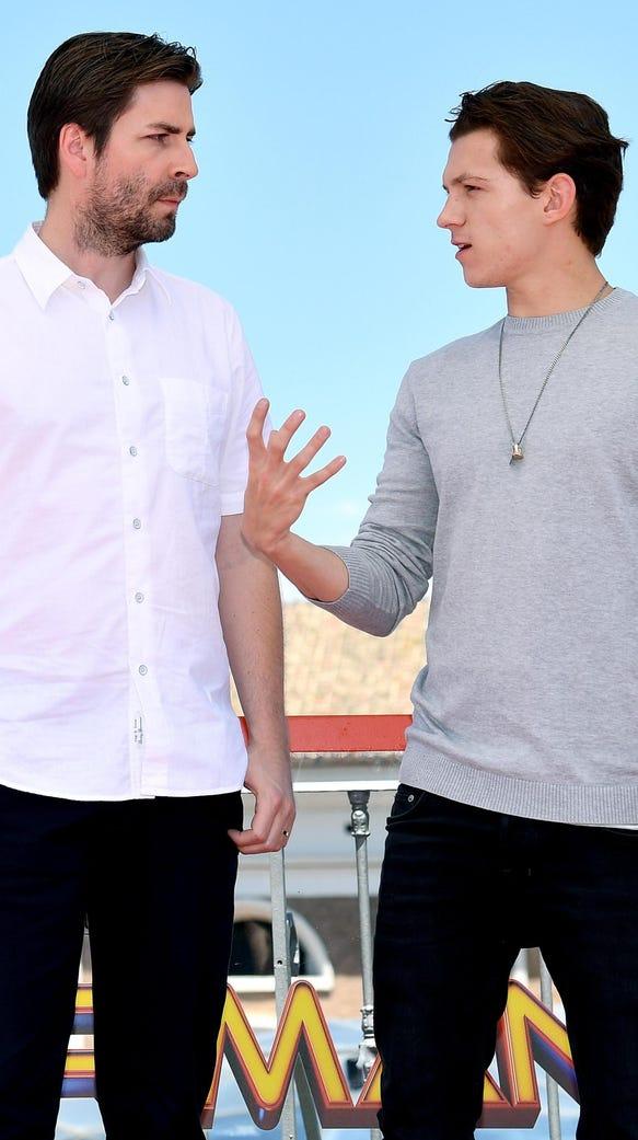 Film director Jon Watts, left, talks to actor Tom Holland.