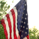 Over 2000 American flags line the streets of McAdenville every Independence Day to honor veterans.