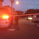 Police launched a manhunt after at least one suspect was shot and an officer was struck by a car in the St. Nicholas neighborhood Thursday evening, authorities said.