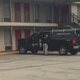 An investigator works the scene Saturday at the Red Carpet Inn on Jeffersonville Road in Macon. One man was killed and another was injured in a shooting there Friday night.