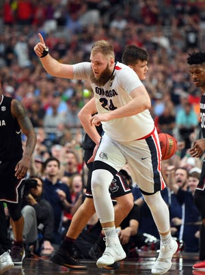 Gonzaga Bulldogs center Przemek Karnowski (24) reacts after a play during the second half against the South Carolina Gamecocks in the semifinals of the 2017 NCAA Men's Final Four at University of Phoenix Stadium.