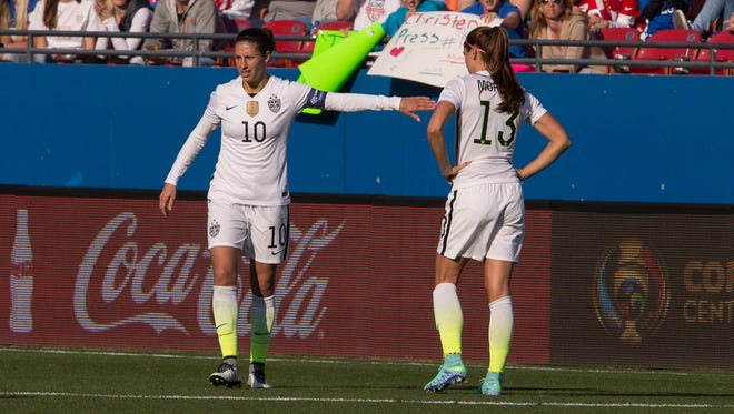 Carli Lloyd, left, and Alex Morgan are two U.S. women's soccer players seeking equal pay to men.