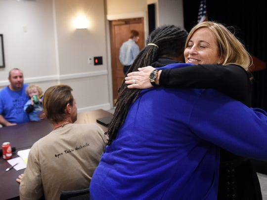 Mayor Megan Barry hugs Howard Allen, who is homeless, before meeting with him and other homeless individuals and members of homeless advocate groups who handed over a petition to do more for the homeless community in Nashville.