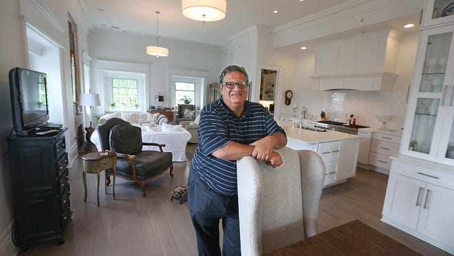 Developer David Pelusio stands in his penthouse suite on the top floor of a house he redeveloped on East Avenue in Rochester. The historic home was redeveloped into a 9-unit rental.