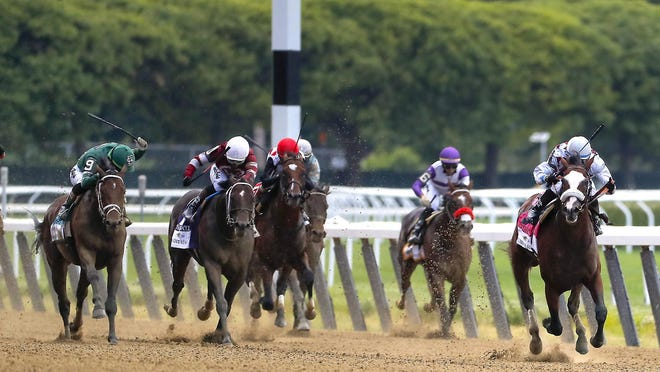 Tiz the Law (right), with jockey Manny Franco up, leads the pack down the home stretch during the152nd running of the Belmont Stakes Saturday in Elmont, New York.