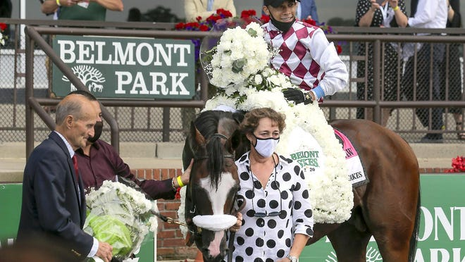 Tiz the Law, with jockey Manny Franco up, poses for a photo with assistant trainer Robin Smullen after winning the 152nd running of the Belmont Stakes Saturday in Elmont, New York.