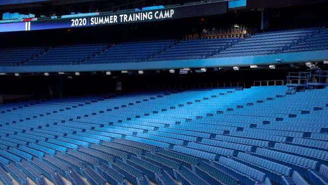 Empty seats are viewed inside Rogers Centre during Toronto Blue Jays summer training camp batting practice in Toronto Sunday.