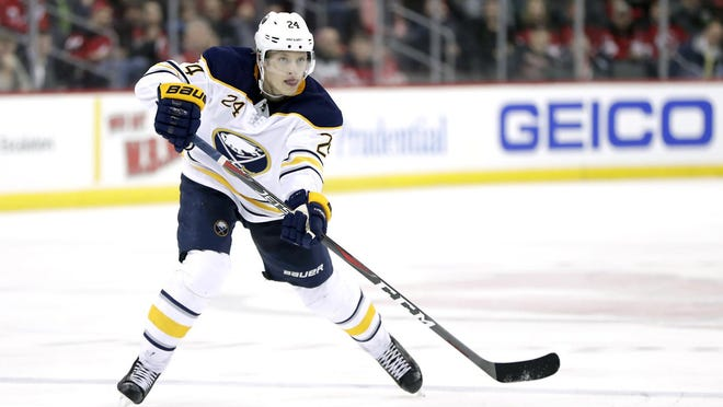 In this March 25, 2019, file photo, Buffalo Sabres defenseman Lawrence Pilut plays against the New Jersey Devils during a game, in Newark, New Jersey. Pilut is leaving the Sabres after signing a two-year contract with Traktor Chelyabinsk of the Kontinental Hockey League.