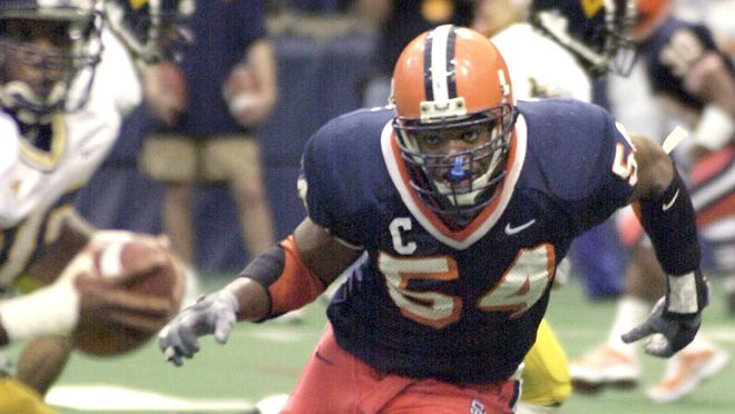 In this Nov. 10, 2001, file photo, Syracuse University defensive end Dwight Freeney (54) bares down on West Virginia quarterback Rasheed Marshall during the fourth quarter of a college football game in Syracuse, New York. Freeney will appear on the College Hall of Fame ballot for the first time. The National Football Foundation announced the 78 players and seven coaches from major college who are up for selection to the Hall of Fame Tuesday.