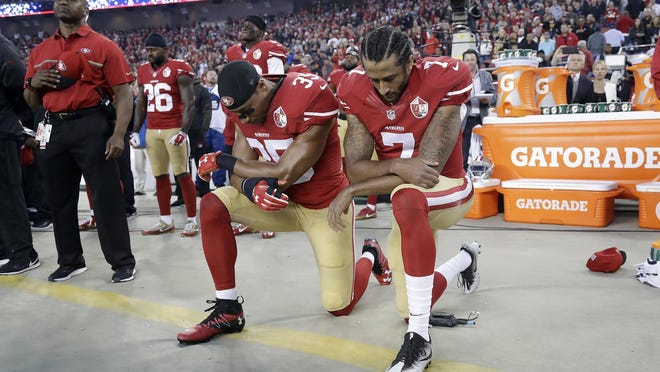 In this Sept. 12, 2016, file photo, San Francisco 49ers safety Eric Reid and quarterback Colin Kaepernick (from left) kneel during the national anthem before an NFL game against the Los Angeles Rams in Santa Clara, California.