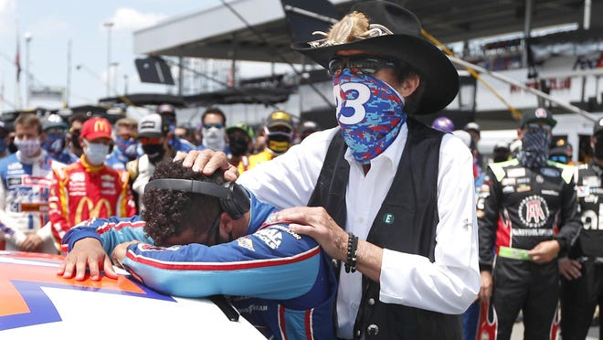 NASCAR driver Bubba Wallace is consoled by team owner Richard Petty (right) prior to the start of the NASCAR Cup Series race at the Talladega Superspeedway Monday in Talladega, Alabama.