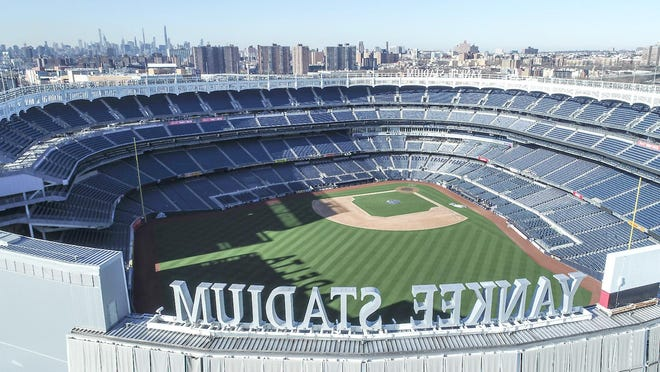 This March 26 photo shows an empty Yankee Stadium on scheduled opening day due to COVID-19 coronavirus restrictions in the Bronx borough of New York.