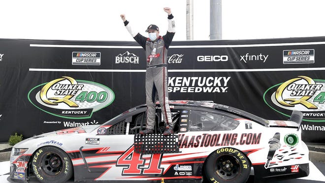Cole Custer celebrates after winning a NASCAR Cup Series race Sundayin Sparta, Kentucky.