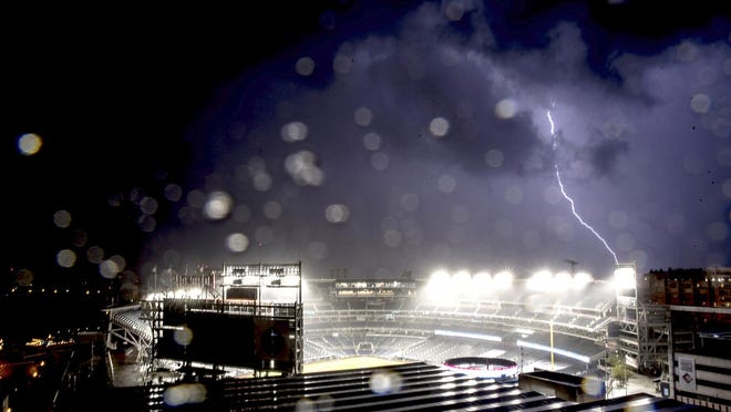 Rain and lighting halt an opening day baseball game between the New York Yankees and the Washington Nationals at Nationals Park Thursday.