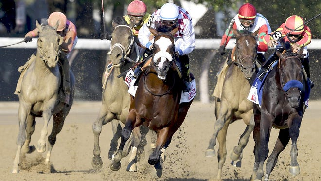 Tiz the Law (center), with Manny Franco up, leads the pack around the final turn on his way to a win in the Travers Stakes Saturday in Saratoga Springs, New York.