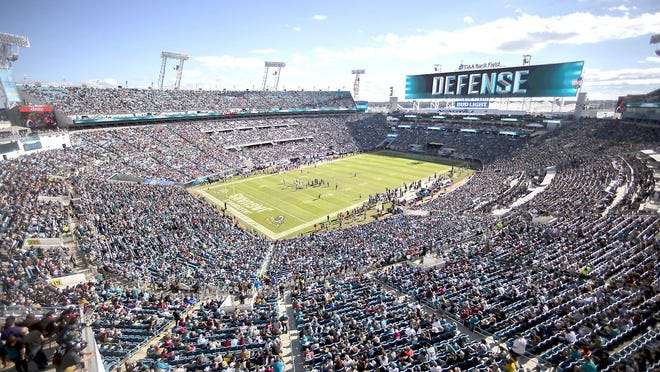 In this Dec. 16, 2018, file photo, fans watch during the first half of a game between the Jacksonville Jaguars and the then Washington Redskins in Jacksonville, Florida. The Jaguars, along with Cincinnati, Miami, Tampa Bay and maybe a few others, might be best equipped to handle the NFL's drastic change in hometown support. They have dealt with it for years.